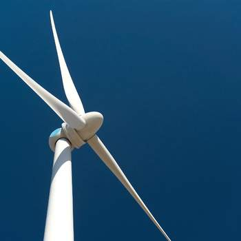 Wind turbine against deep blue sky
